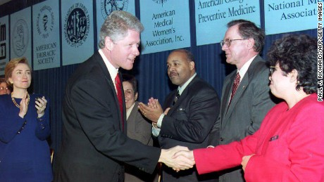WASHINGTON: US President Bill Clinton talks to Dr. Elena Rios and other physicians that announced their support for his health reform package during a ceremony at the White House. Behind Clinton is First Lady Hillary Clinton on December 16.
