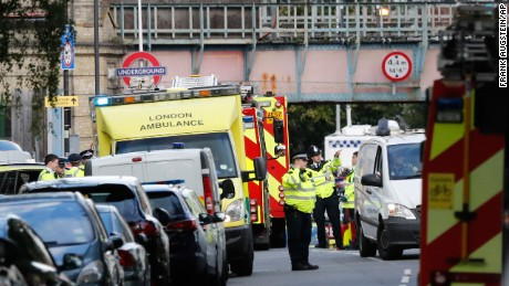 Ambulances and police stand nearby after an incident on a tube train at Parsons Green subway station.