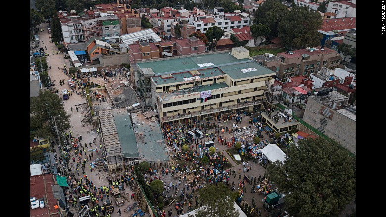 """Volunteers and rescue workers search for children <a href=""""http://www.cnn.com/2017/09/20/world/enrique-rebsamen-school-mexico-earthquake-trnd/index.html"""" target=""""_blank"""">trapped inside Mexico City's Enrique Rebsamen school </a>on Wednesday, September 20. The school collapsed the day before when a magnitude 7.1 earthquake struck the region."""