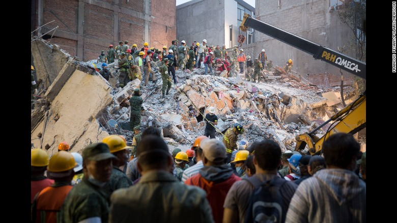 People look for survivors in Mexico City on September 20. The earthquake happened on the anniversary of a 1985 quake that killed an estimated 9,500 people in and around Mexico City.