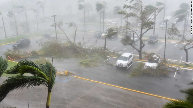 """Trees are toppled outside the Roberto Clemente Coliseum in San Juan, Puerto Rico, on Wednesday, September 20. Hurricane Maria is churning through the Caribbean, threatening islands that were already crippled <a href=""""http://www.cnn.com/2017/09/07/americas/gallery/hurricane-irma-caribbean/index.html"""" target=""""_blank"""">by Hurricane Irma</a> earlier this month."""