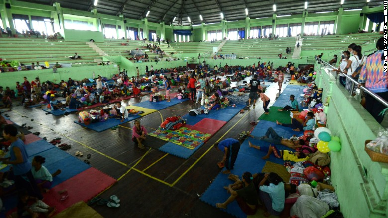 People wait inside an evacuation centre in Klungkung regency, on the Indonesian resort island of Bali on September 25, 2017.