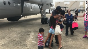 Families leave working loved ones behind to help Puerto Rico