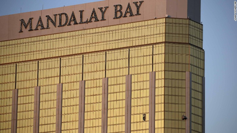 """Broken windows of the Mandalay Bay hotel are seen early in Las Vegas on Monday, October 2. Dozens were killed and hundreds injured after <a href=""""http://www.cnn.com/2017/10/02/us/las-vegas-shooter/index.html"""" target=""""_blank"""">a shooting at a country music festival</a> the night before. Police said the gunman fired on the crowd from the 32nd floor of the Mandalay Bay, several hundred feet southwest of the concert grounds. It is the deadliest mass shooting in modern US history."""