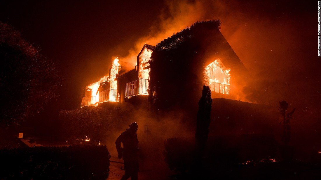 A building burns in Napa on October 9.