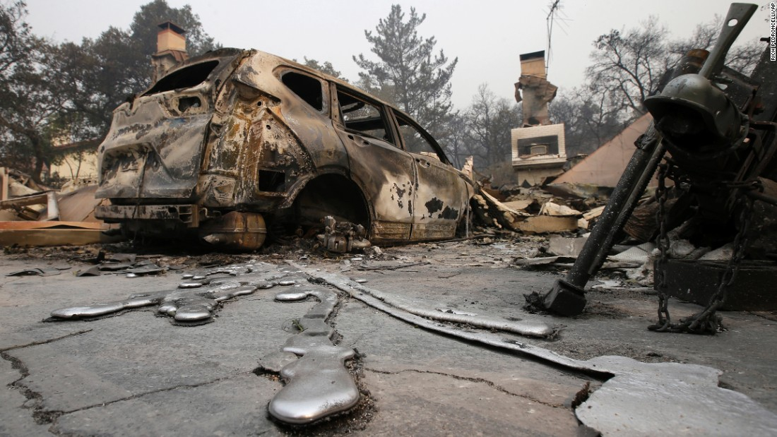 Puddles of melted metal trail away from a burned-out car near Napa on October 10.