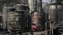 Damaged winemaking vats and tanks stand in ashes and debris at the Paradise Ridge Winery in Santa Rosa.